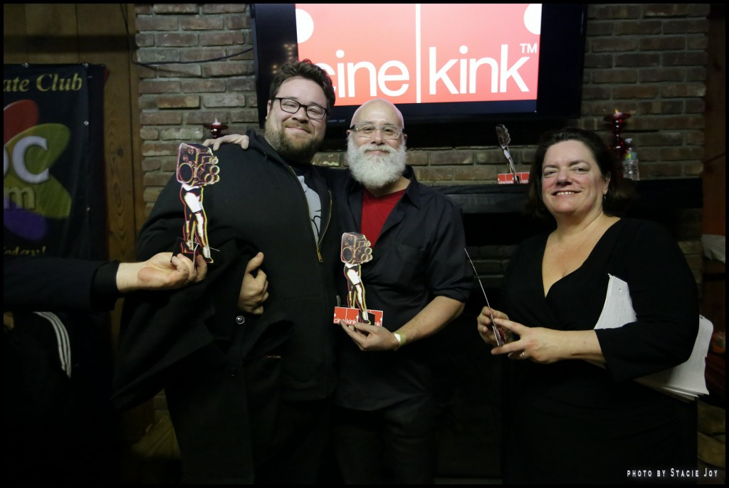 The Red Umbrella Diaries David Kornfield and Chris Fiore accept an award from CineKink's Lisa Vandever